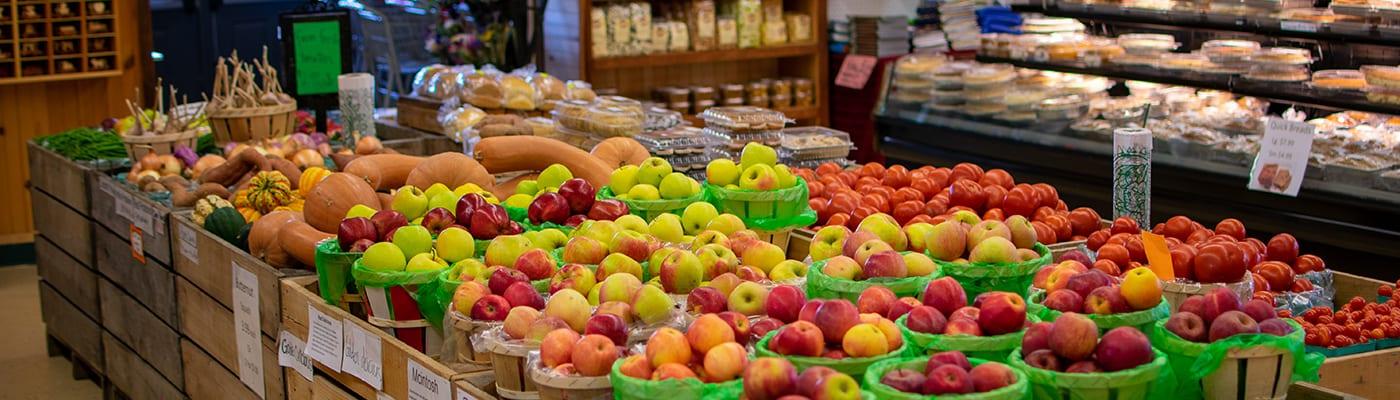 apples in baskets inside market